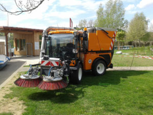 multihog with sweeper attachments