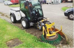 multihog with sweeper attachment