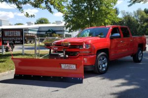 western plow attached to truck
